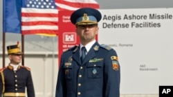 A Romanian officer awaits a ceremony marking the construction of a U.S. Aegis Ashore missile-defense base in Deveselu, Romania, in 2013. The system has long been a worry for Russia.