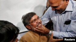 Kailash Satyarthi (center) is congratulated on winning the Nobel Peace Prize at his office in New Delhi.