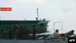 An Al Arabiya screen grab of an Iranian boat is seized by Yemeni coast gaurds in the Red Sea for allegedly carrying arms to Shi'ite rebels locked in fierce fighting with the army since August in the rugged mountains of northern Yemen.