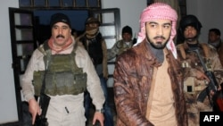 Tribal militia commander Muhammad Khamis Abu Risha (right) says only about 10 percent of Ramadi is still controlled by the insurgents.