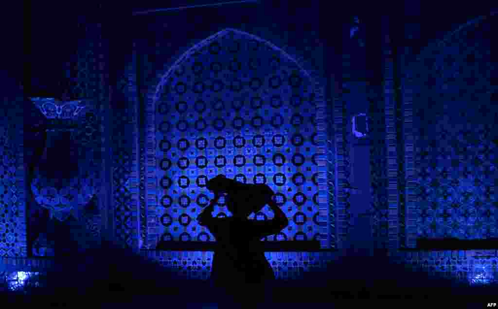 An Afghan walks through the courtyard of the Hazrat-e Ali shrine, or Blue Mosque, during the Islamic holy month of Ramadan in Mazar-e Sharif. (AFP/Farshad Usyan)