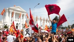 Macedonia - Protestors wave Macedonian and Albanian flags during a rally in front of the Government Building in Skopje, May 17,2015