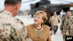 Chancellor Angela Merkel talks with a German soldier during a visit to a base in Konduz, in northern Afghanistan, on May 10.