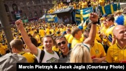 Polish fans Jacek (left) and Piotrek amid a sea of Swedish supporters during the Euro 2012 soccer championships in Kyiv on June 15.