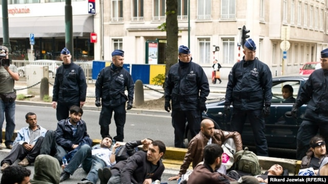 Afghan asylum seekers block a road in Brussels after being evicted from their shelter by Belgian police on June 16.