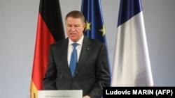 Romanian President Klaus Iohannis has called on the government to reveres a series of judicial reforms criticized by the U.S. and EU.