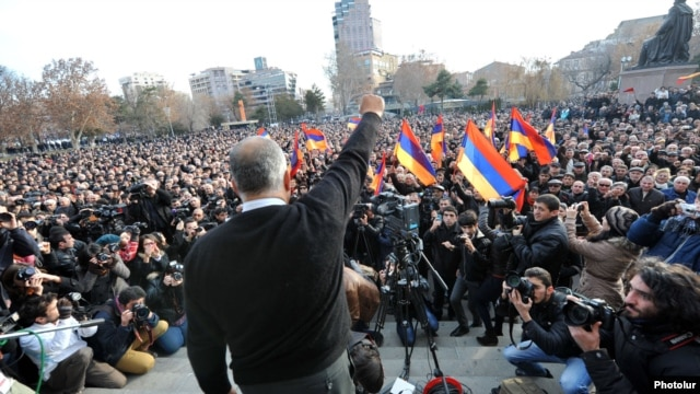 Armenian opposition leader Raffi Hovannisian gestures to the crowd at a rally in Liberty Square in Yerevan on February 20.