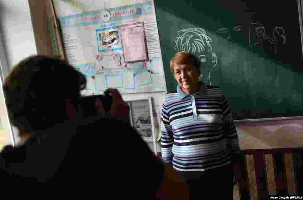 "The day before, van Helten had visited a local school to photograph Marina Marchenko, whom he chose after seeing a photograph of the 73-year-old teacher. ""I could just see the kindness in her eyes...I want my work to have a local identity."""
