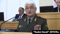 "Tajik Defense Minister Sherali Hairulloev, shown appearing in parliament on October 1, was replaced ""due to health issues."""