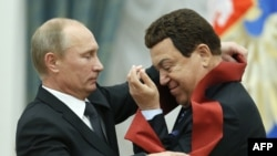 Russian President Vladimir Putin awards a medal to singer Iosif Kobzon (right) during a ceremony in the Kremlin in Moscow in August 2012.