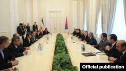 Armenia - Presidents Serzh Sarkisian and Mahmud Ahmadinejad lead Armenian-Iranian talks in Yerevan, 23Dec2011.