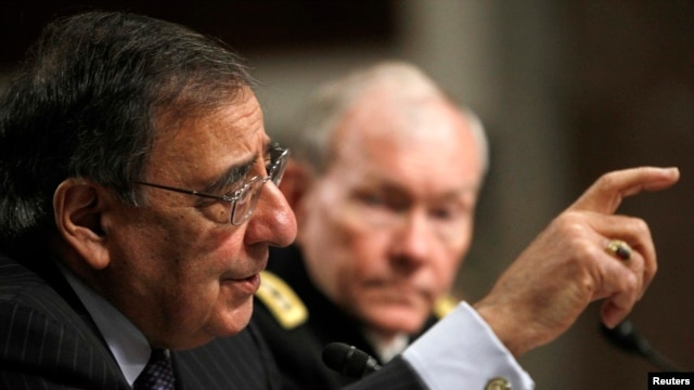 U.S. Secretary of Defense Leon Panetta (left) and U.S. Army General Martin Dempsey, the chairman of the Joint Chiefs of Staff, testify before the Senate Armed Services Committee on February 7.