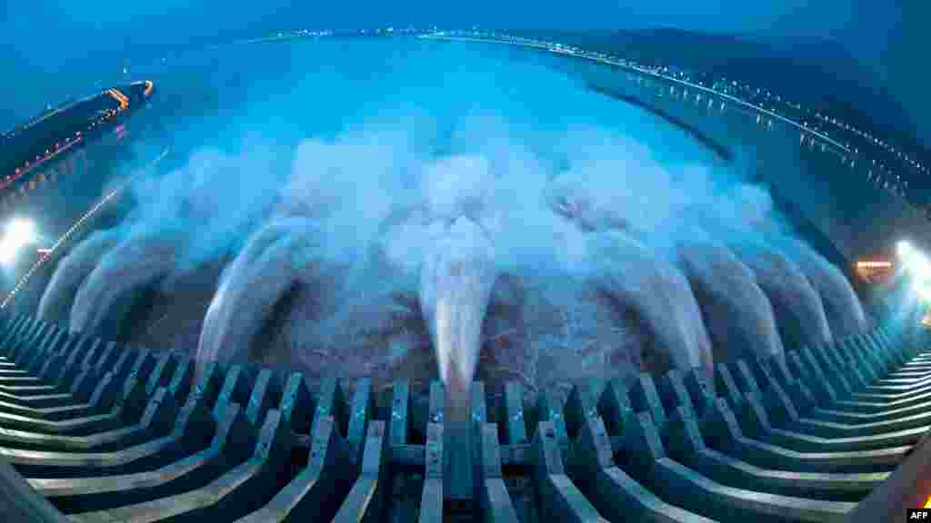Water is released from the Three Gorges Dam, the gigantic hydropower project on the Yangtze River in central China's Hubei Province on July 24 after heavy downpours in the upper reaches of the dam caused the highest flood peak of the year. (AFP)