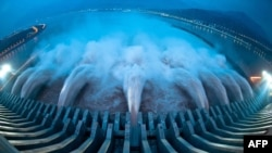 Water is released from the massive Three Gorges Dam, a hydropower project on the Yangtze River in Yichang, in central China's Hubei province, on July 24.