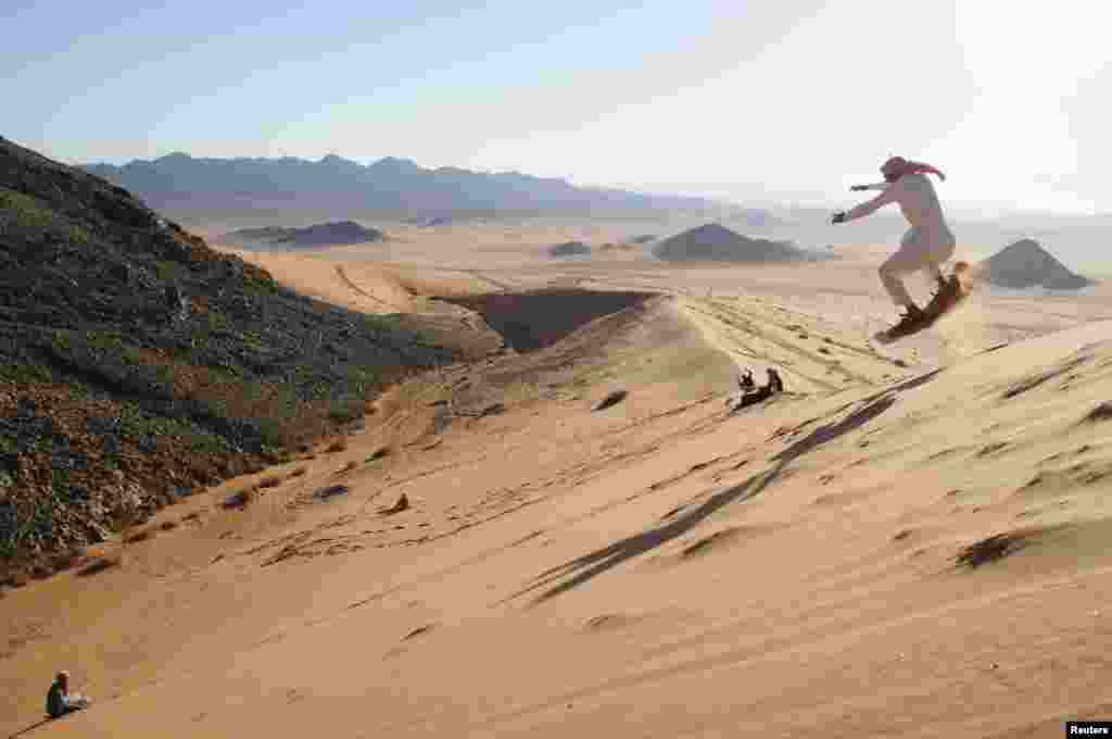 A man sand skis in the desert near Tabuk, 1,500 kilometers from Riyadh, Saudi Arabia. (Reuters/Mohamed Alhwaity)