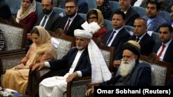 Afghan President Ashraf Ghani (center) attends a consultative grand assembly known as the Loya Jirga in Kabul on April 29.