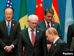 Президент Росії Володимир Путін біля тодішнього голови Європейської ради Германа Ван Ромпея під час саміту G20. Брісбен, Австралія. 15 листопада 2014 року