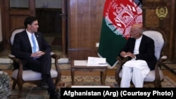 Afghan President Ashraf Ghani (right) meets with U.S. Defense Secretary Mark Esper in Kabul on October 20.