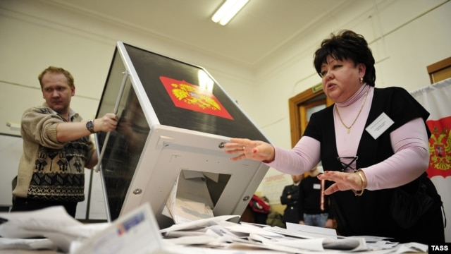 Members of the local electoral commission open ballot boxes at a polling station in Vladivostok.