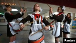 Belarusian schoolchildren, who are members of a pro-government Young Pioneer movement, perform with drums as they take part in a meeting to mark the 95th anniversary of their organisation in Minsk on May 19. (Reuters/Vasily Fedosenko)