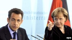 French President Nicolas Sarkozy (left) and German Chancellor Angela Merkel have both criticized Russia's actions, but in varying ways.