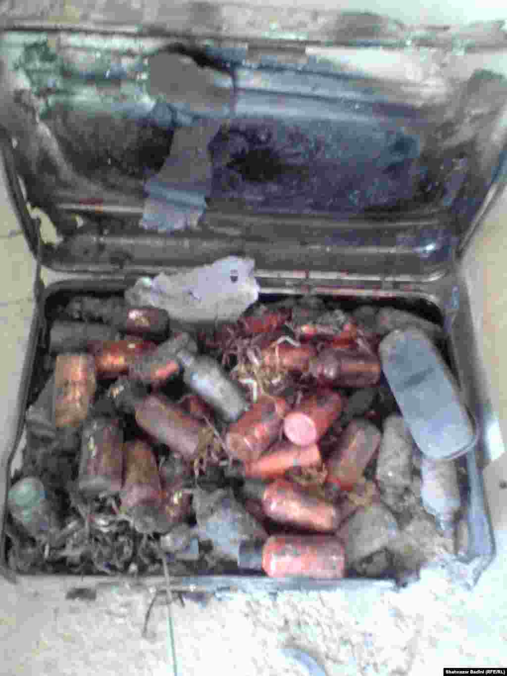 The Taliban leader's suitcase, which apparently shows a lot of bottles of an unknown chemical or medicine. Some media reports suggest he had gone to Iran for medical treatment.