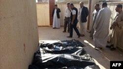 حمله به موصل (قربانیان در تصویر) دستکم ۱۵ کشته بر جای گذاشت