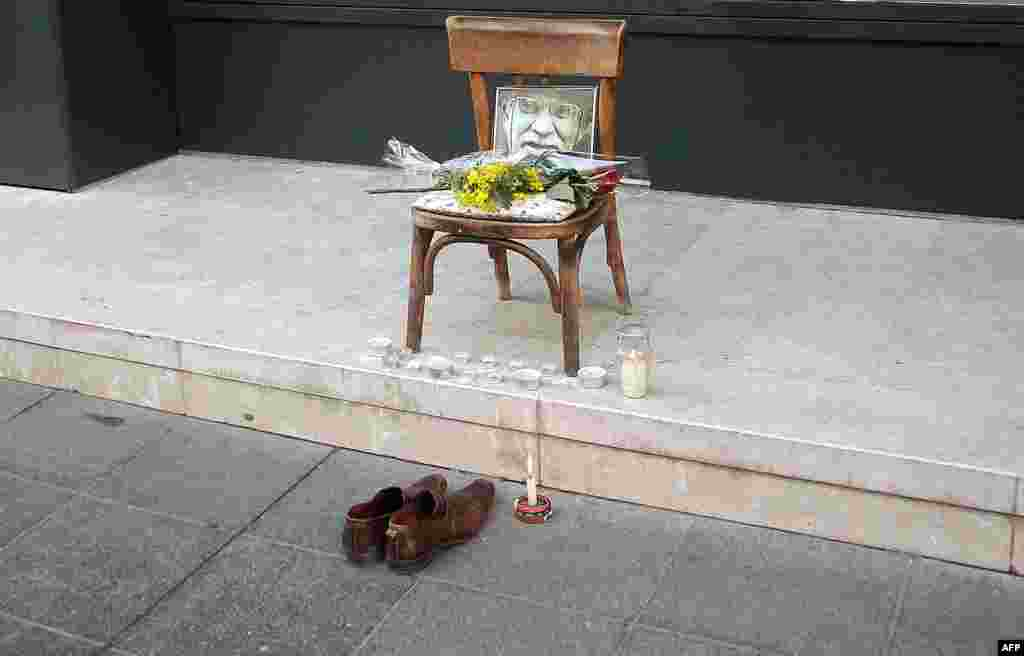 "A makeshift memorial with a picture of legendary shoe cleaner ""Uncle"" Miso is seen on a main street in Sarajevo. (AFP/Elvis Barukcic)"