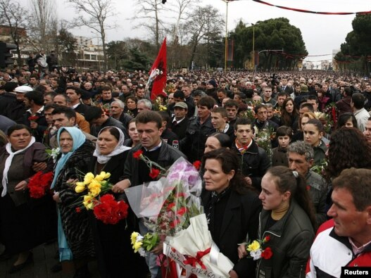 People attend a march to commemorate the three victims of last week's deadly riots in Tirana.