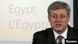 "Canadian Prime Minister Stephen Harper has described Russia's actions in Ukraine as ""aggressive, militaristic, and imperialistic."""