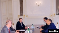 Azerbaijani President Ilham Aliyev (right) receives cochairs of the OSCE Minsk Group