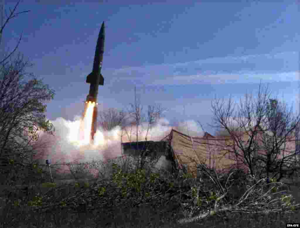 A Russian Tochka missile, capable of carrying half a ton of explosives, is launched towards a road used by Chechen rebels in November 1999. Russian forces fired several tactical ballistic missiles that slammed into central Grozny on October 21, killing more than 100 people instantly and sparking international outrage.