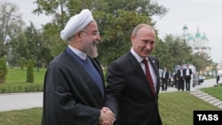 Рускиот претседател Владимир Путин и иранскиот Хасан Рохани.