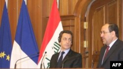 President Sarkozy (left) with Prime Minister al-Maliki at a joint press conference in Baghdad on February 10