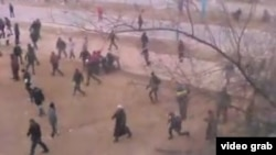 A still from an amateur video taken as protesters fled police in Zhanaozen on December 16, 2011.