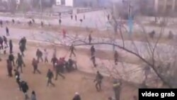 Rights groups have criticized the Kazakh government for its response to December riots in the Western oil town of Zhanaozen, as purportedly shown in this YouTube screen grab.