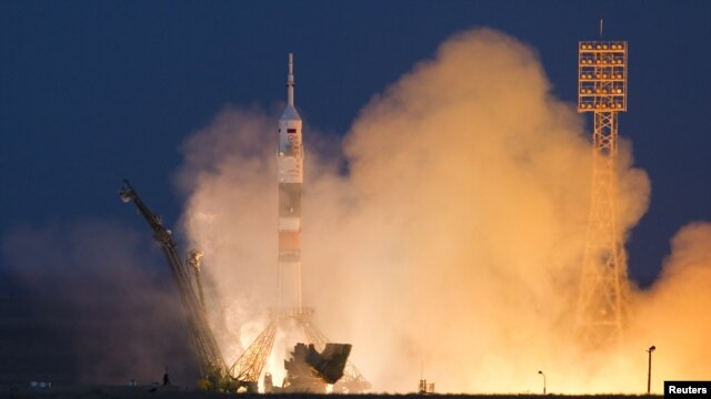 The Soyuz TMA-07M spacecraft carrying a three-man crew blasts off from the Baikonur Cosmodrome.