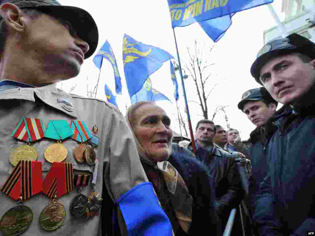 Veterans and invalids of the Soviet war in Afganistan and other wars and armed conflicts rally in front of the Cabinet of Ministers in Kyiv on November 10. Protesters demand their social safeguards and benefits to be saved following a government plan to cancel them next year. Photo by Sergei Supinsky for AFP