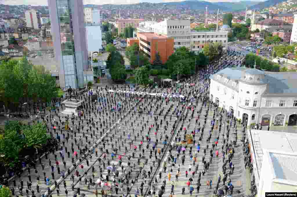 Hundreds of supporters of Kosovo's interim prime minister maintain careful physical distancing at a protest in Pristina on May 28.