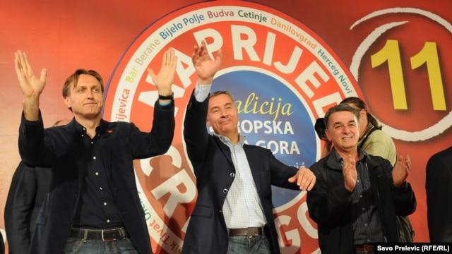 Veteran Montenegrin leader Milo Djukanovic (center) celebrates the win by his Coalition for European Montenegro.