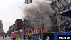 U.S. -- Boston explosions. screenshot of Boston Globe Video, 15Apr2013