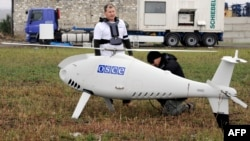 OSCE personnel prepare an unmanned drone near Mariupol in Ukraine in October 2014.