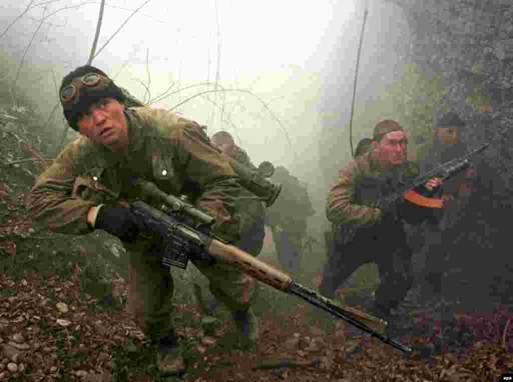 Russian marines on patrol in February 2000. After the capture of Grozny, militants operated from the mountains and forests in a new phase of the war.
