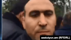 Armenia -- A plainclothes man attacks RFE/RL's Arus Hakobian in Artashat, 21Apr2018.