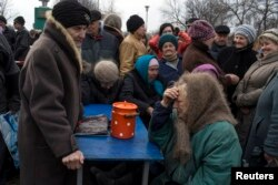 People queue for free food distributed by pro-Russian rebels near the town of Debaltseve last month.