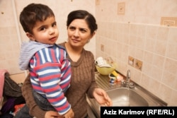 Rafiyeva with her 3-year-old son, Amin.