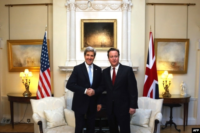 British Prime Minister David Cameron (right) meets with Kerry at 10 Downing Street.