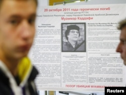 "A memorial board for Muammar Qaddafi at the Russian State University of Trade and Economics in Moscow reads: ""On October 20, 2011, Muammar Qaddafi died heroically. Shame on Muammar Qaddafi's killers."""