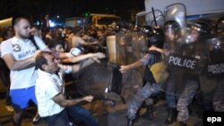 Protesters clash with police on July 20, 2016, near a police station that was seized by armed men a few days earlier.