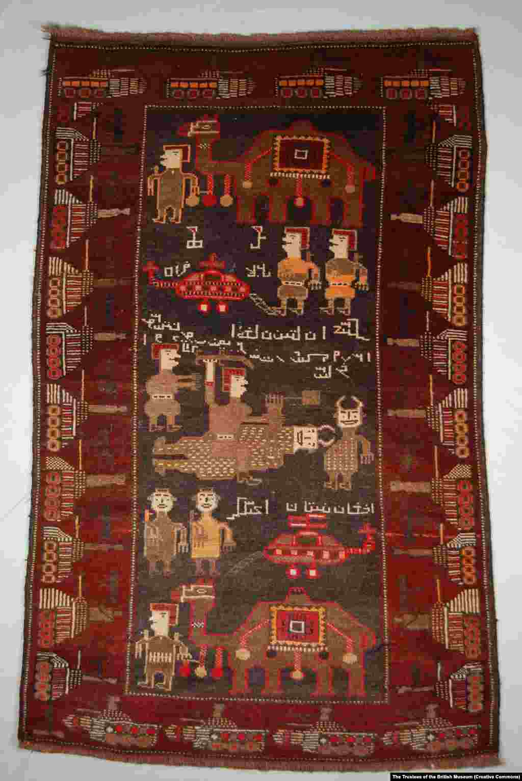 A rug centered around an illustration of Afghan fighters with camels killing Soviet soldiers. The foreign troops are depicted as horned devils.   These rugs belong to the British Museum, which in late April made nearly 2 million photographs from its collections available for publication. More than a dozen war-themed Afghan rugs are held by the museum.